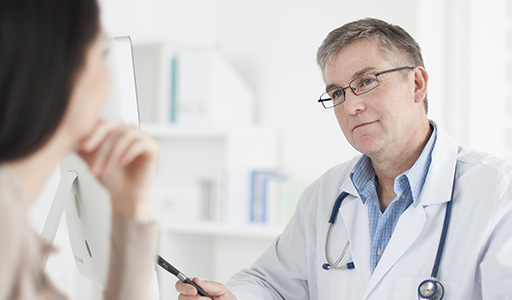 Physician listening to patient's heart