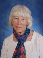Photo of Susan Burke wearing colorful scarf